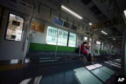 A man with protective mask rides an empty train Wednesday, April 8, 2020, in Tokyo. Japanese Prime Minister Shinzo Abe declared a state of emergency yesterday for Tokyo and six other prefectures. (AP)