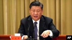 Presiden Xi Jinping memberikan pidato di Beijing, hari Rabu (2/1).