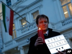 FILE - Richard Ratcliffe husband of imprisoned charity worker Nazanin Zaghari-Ratcliffe, poses for the media during an Amnesty International led vigil outside the Iranian Embassy in London, Jan. 16, 2017.