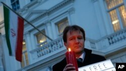 FILE - Richard Ratcliffe, husband of imprisoned charity worker Nazanin Zaghari-Ratcliffe, poses for the media during an Amnesty International led vigil outside the Iranian Embassy in London, Jan. 16, 2017.