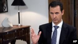 바샤르 알 아사드 시리아 대통령이 11일 다마스쿠스에서 스페인 EFE 통신과 인터뷰하고 있다.