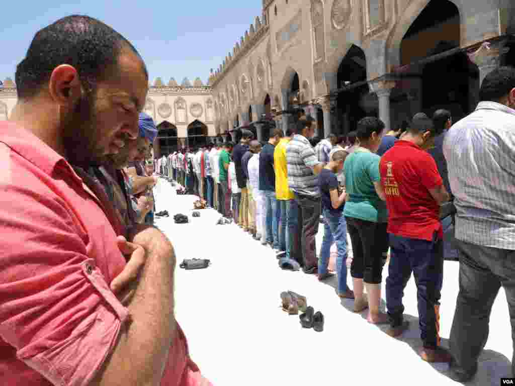 Muslims stand in lines at Friday's prayers at Al-Azhar Mosque. Since the clashes of 2013, the Egyptian government has put together a plan they say prevents hate speech in mosques. Each week, the Al-Azhar mosque presents Egyptian clerics with a topic or t