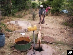 "Ethiopian ""farmer-priest"" Kas Malede Abreha works the water pump he built … The simple contraption has changed his life …"