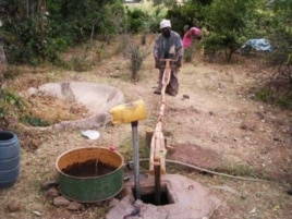 """Ethiopian """"farmer-priest"""" Kas Malede Abreha works the water pump he built … The simple contraption has changed his life …"""