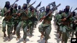 FILE - Al-Shabab fighters conduct exercises on the outskirts of Mogadishu, Somalia, Feb. 17, 2011. The U.S. military said it conducted an airstrike Dec. 15, 2018, nearGandarhse, south of Mogadishu, that killed at least eight al-Shabab militants.