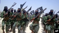 FILE - Al-Shabab fighters are seen marching with their weapons during exercises on the outskirts of Mogadishu, Somalia, Feb. 17, 2011. The Pentagon says President Donald Trump has given it more authority to attack al-Shabab targets