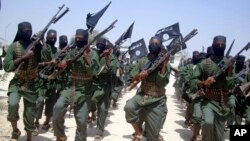 FILE - Al-Shabab fighters are seen marching with their weapons during exercises on the outskirts of Mogadishu, Somalia, Feb. 17, 2011. Somalia-based al-Shabab fighters often strike within Kenya.