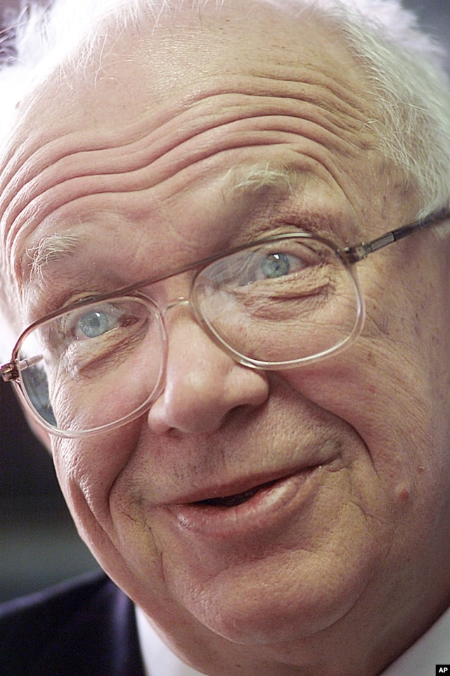 FILE - A 2001 photo of Sergei Khrushchev, the son of the late Soviet leader, speaking to reporters in his Brown University office in Providence, R.I.