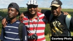 Nathan Sipho Banana (center) with his brothers posing for a photo. (Photo By Nathan Sipho Banana)