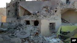 This photo provided by the Shafak Charity Organization, which has been authenticated based on its contents and other AP reporting, shows the badly damaged exterior of a medical facility dedicated to women after it was hit by four airstrikes in the norther