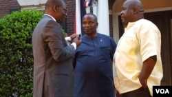 Rep Togba Mulbah (R) and George Mulbah (C) speak with VOA's James Butty (L)
