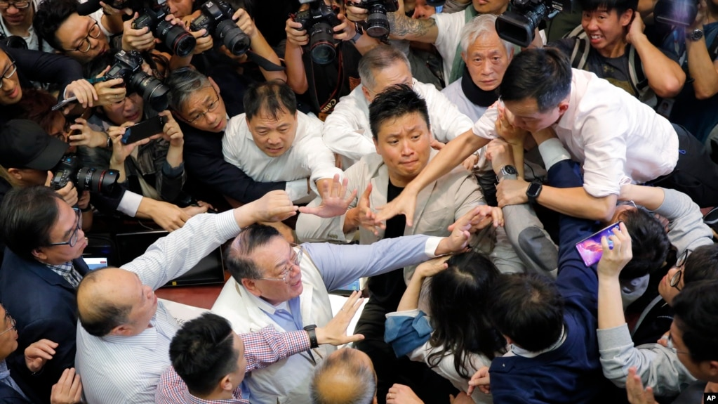 Hong Kong Lawmakers Brawl Over Extradition Bill