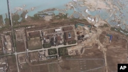 FILE - Satellite image provided by GeoEye shows the area around the Yongbyon nuclear facility in Yongbyon, North Korea. The U.S.-Korea Institute at Johns Hopkins School of Advanced International Studies said shows that North Korea has resumed building wor