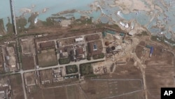 FILE - Satellite image provided by GeoEye shows the area around the Yongbyon nuclear facility in Yongbyon, North Korea.
