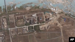 FILE - Satellite image provided by GeoEye shows the area around the Yongbyon nuclear facility in Yongbyon, North Korea. The U.S.-Korea Institute at Johns Hopkins School of Advanced International Studies said shows that North Korea has resumed building work on a reactor after months of inactivity at the site.
