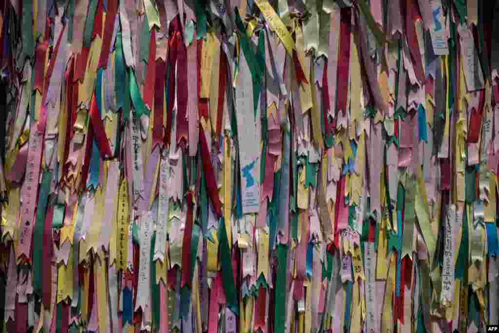 Ribbons featuring messages are displayed on a fence at the Imjingak Peace Park near the Demilitarized Zone (DMZ) separating North and South Korea in Paju. Washington's top diplomat, Secretary of State Rex Tillerson, visited the Demilitarized Zone dividing the two Koreas to gaze on the North for himself, a day after he declared 20 years of efforts to denuclearize it had failed.