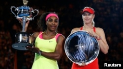 Serena Williams (L) of the United States and Maria Sharapova of Russia pose with their trophies after their women's singles final match at the Australian Open 2015 tennis tournament in Melbourne January 31, 2015.