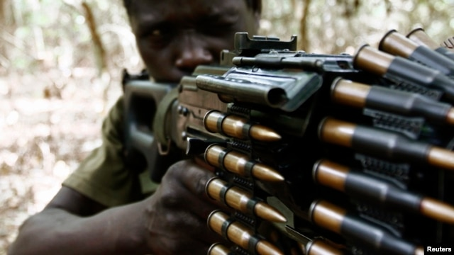 A Ugandan soldier tracking down Lord's Resistance Army (LRA) fugitive leaders takes position behind a machine gun at a forest bordering Central African Republic (CAR), South Sudan and Democratic Republic of Congo, near river Chinko, (File photo).