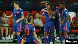 L'équipe colombienne fête son troisième but contre la Pologne, lors de la Coupe du Monde 2018, Kazan, le 24 juin 2018.