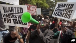 Kenyans demonstrate against their Members of Parliament who last week quietly awarded themselves a $110,000 bonus for five years of service in parliament, in downtown Nairobi, Kenya, October 9, 2012.