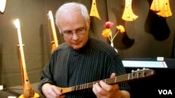 "Bob McNally plays the ""Strumstick."""