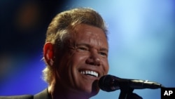 Randy Travis performs on day 2 of the 2013 CMA Music festival at the LP Field in Nashville, Tenn., June 7, 2013.