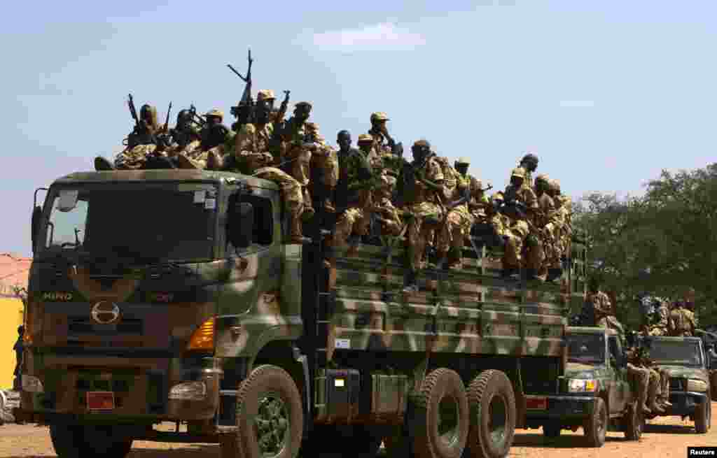 The Sudan People's Liberation Army (SPLA) soldiers ride in a truck in Juba, South Sudan, Dec. 21, 2013.