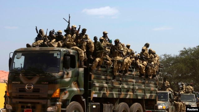 SPLA soldiers drive in a truck in Juba December 21, 2013. African mediators sought on Saturday to meet rivals to South Sudan's president in a bid to end fighting that threatens to drag the world's newest country into an ethnic civil war. REUTERS/Stringer