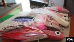 Some of Elpheus Ndlovu's sailfish flies. (Darren Taylor for VOA News)