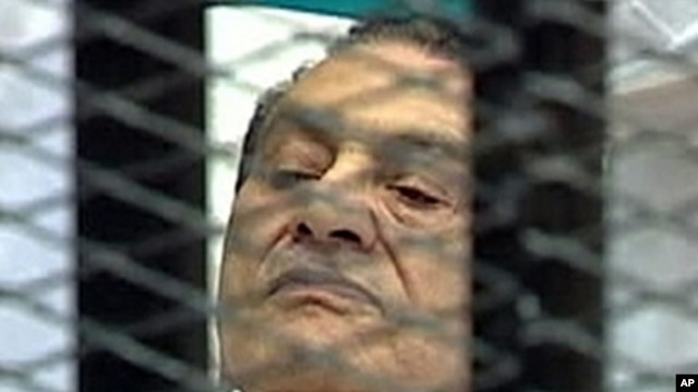 Former Egyptian President Hosni Mubarak is seen in the courtroom for his trial at the Police Academy in Cairo, August 3, 2011.