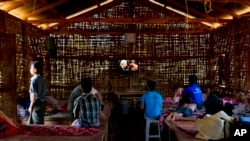 FILE - Young drug addicts watch television at a drug rehabilitation center run by the Kachin Baptist Community at Nampatka Village, Northern Shan State, Myanmar.