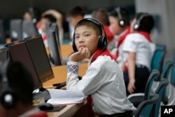 In this June 16, 2017, photo, North Korean students use computer terminals at the Sci-Tech Complex in Pyongyang, North Korea.