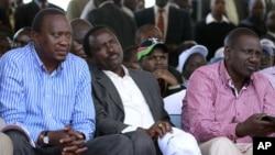 Kenya's Finance Minister Uhuru Kenyatta (L), Kenya's Vice President Kalonzo Musyoka (C) and suspended Higher Education Minister William Ruto (R) attend a prayer meeting at the Uhuru Park grounds in the capital Nairobi, April 11, 2011.
