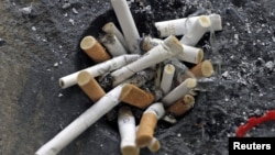 Cigarette butts are seen in an ashtray in Los Angeles, California, May 31, 2012.