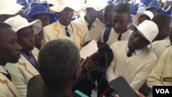 Njube High School students speaking with a provincial education official in Bulawayo.