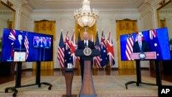 Presidente Joe Biden em conversa virtual com os primeiros-ministros da Austrália, Scott Morison (esq) e do Reino Unido, Boris Johnso (dir). 15 de Setembro de 2021