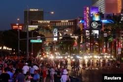 Tourists enjoy the Las Vegas Strip as they visit Las Vegas, Nevada, Aug. 27, 2018.