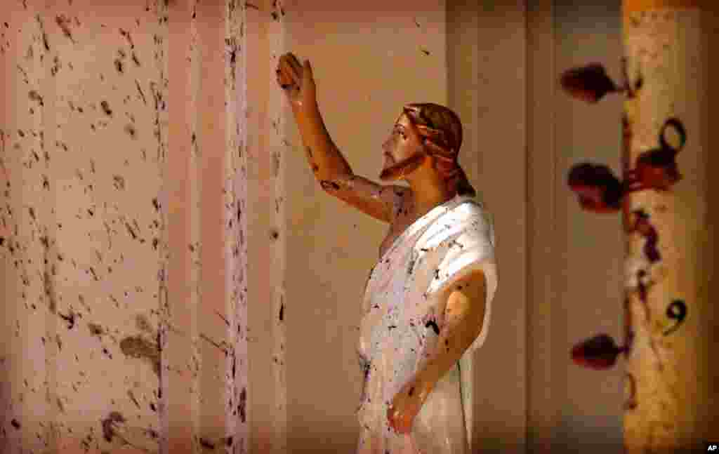 Blood stains are seen on the wall and on a Jesus Christ statue at the St. Sebastian's Church after blast in Negombo, north of Colombo, Sri Lanka. More than 200 people were killed and hundreds more injured in eight blasts that rocked churches and hotels in and just outside the capital on Easter Sunday.