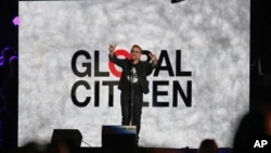 U2 lead singer Bono speaks at the Global Citizen Festival in Central Park in New York on Saturday, Sept. 26, 2015. The annual event is aimed at ending poverty around the world.