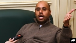 Saif al-Islam Gadhafi, son and heir apparent of Libyan leader Moammar Gadhafi, speaks to a reporter in Tripoli on February 26, 2011