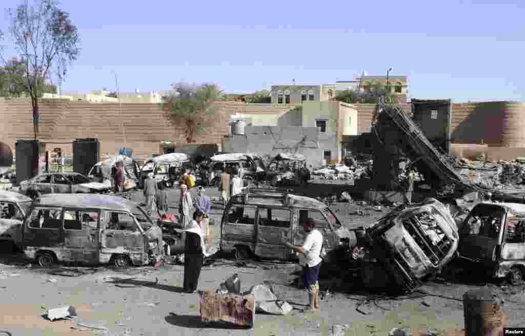 Destroyed vehicles are seen at a gas station after it was hit by an airstrike in Yemen's northwestern city of Saada, April 16, 2015.