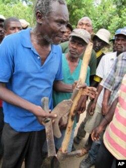 Many farmers in Haiti use rudimentary tools.