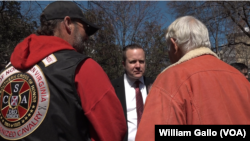 "Virginia gubernatorial candidate Corey Stewart (rear, center) is seen at an ""End Sanctuary Cities Rally"" in Richmond, Virginia, March 2017. Stewart is using President Donald Trump as a model for his race to win the Republican Party nomination for governor of Virginia."