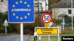 FILE -- A street sign marks the beginning of Schengen, Luxembourg. Schengen Agreement with the goal to illiminate internal border controls was signed there June 14, 1985. The European Union says it won't extend the temporary border controls beyond November.
