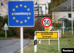 A street sign marks the beginning of Schengen, Luxembourg, January 27, 2016. The Schengen Agreement with the goal to illiminate internal border controls was signed on June 14, 1985 in the small village at the river Moselle and the tripoint of France, Germany and the Netherlands.