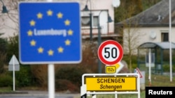 FILED - A street sign marks the beginning of Schengen, Luxembourg January 27, 2016. The Schengen Agreement with the goal to eliminate internal border controls was signed on June 14, 1985 in the village at the river Moselle and the tripoint of France, Germany and the Netherlands.