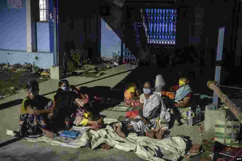 People wait for a Covid-19 coronavirus vaccine at the North Bengal Medical college and hospital on the outskirts of Siliguri, India.