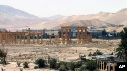 FILE - This file photo released May 17, 2015, by the Syrian official news agency SANA shows the general view of the ancient Roman city of Palmyra, northeast of Damascus, Syria.