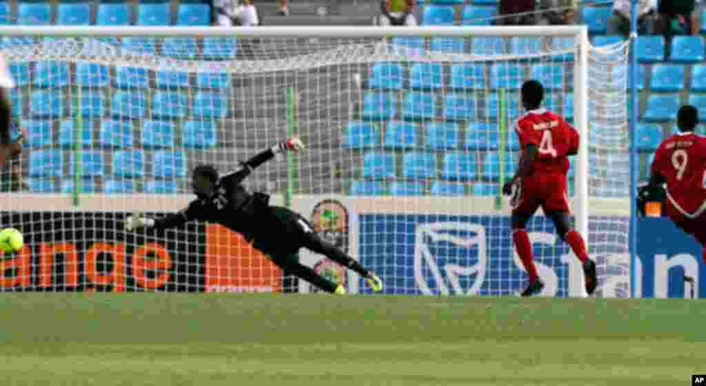 Sudan's Saif Eldin and Nagm Eldin look on as Angola's Manucho scores during their African Nations Cup soccer match in Malabo