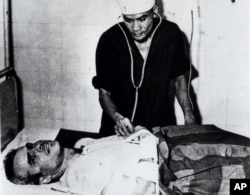 FILE - John McCain is administered to in a Hanoi hospital as a prisoner of war in the fall of 1967.